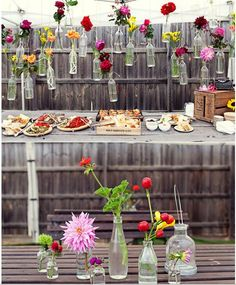 Having a party? Tie vases to the fence and fill with plants or flowers. | 32 Cheap And Easy Backyard Ideas That Are Borderline Genius