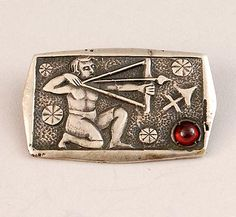 FONS REGGERS 1886-1962 - Silver brooch of the Zodiac- sign Sagittarius with a cobochon cut garnet design execution Gebr Reggers / Amsterdam the Netherlands 1925-1934