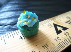 Micro mini thimble sized cupcakes!  These would be great to use with Elf on the Shelf
