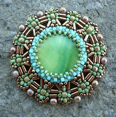 It isn't easy to design beadwork using bugle beads.  This is not only beautiful work but really innovative.  Love it!