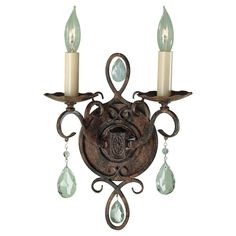 Hosting glowing candelabra lights and suspended glass crystals, this glamorous light fixture adds an elegant ambiance to your wash room. This sturdy steel fixture is iced in mocha bronze for a glorious finish.
