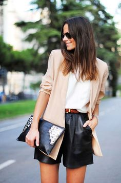 Wondering how to get away with wearing shorts to the office when the weather turns warm? Look to this image for inspiration: vegan leather shorts in a conservative cut with blazer, white top, and oversize clutch.. DIY the look yourself: http://mjtrends.com/pins.php?name=vegan-leather-fabric-black-material