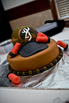 Camo Hat Grooms Cake - A Grooms cake I made with a camo Browning hat and shotgun shells. TFL!