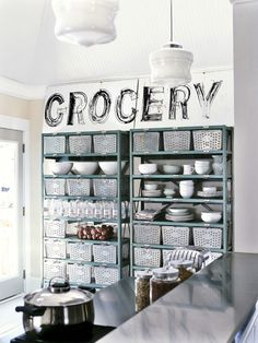 No space for a pantry? No problem! Just outfit a utilitarian shelving system with breathable baskets that can corral everything from various types of produce to bulky bags of dry goods like flour and sugar.