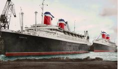 Running mates SS America and SS United States docked in Cherbourg. While very similar in design, the America (1940) and United States (1952) had many differences. 2 of the main visual difference is the America was over 200 ft. shorter and its funnels were not as streamlined as the Big U's.