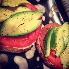 avocado, tomato, and hummus on a whole-grain English muffin