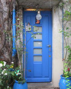 Door sign in French: I'm in the garden