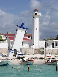 Lighthouse and leaning tower in Puerto Morelos, Mexico