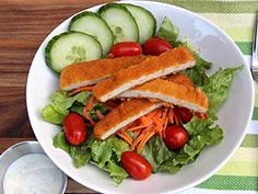 Breaded Chicken Tender Salad - Adding chicken tenders to a salad is a great way to incorporate servings of vegetables into any lunch. Tenders can be cut for easy eating or left whole.
