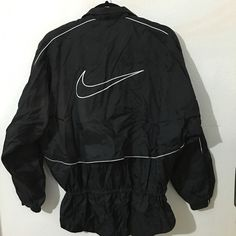 Vintage Nike Windbreaker In excellent condition and is a Womens size medium. No stains or rips. Oversized fit. Has two front pockets and a drawstring waistline . Color is black Nike Jackets & Coats