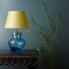 This Fandango light has the softest blue blown glass base. Like a beautiful vase that we have lampified. Very sophisticated and, in the right surroundings, a showstopper. Table Lamp Base, Lamp Bases, Table Lamps, Pooky Lighting, Expensive Candles, Build A Table, Candle Maker, Blue Candles, Vase