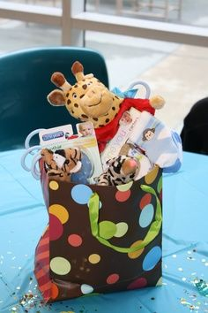 Centerpiece Table Baby Boy Outfits   safari baby shower centerpieces were a bag of goodies for the baby