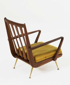 Anonymous; Walnut and Brass Lounge Chair, 1960s.
