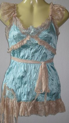 vintage inspired satin top with ruffles of lace and vintage motifs....... $40.00, via Etsy.
