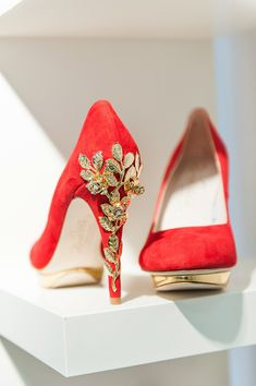 Harriet Wilde red wedding shoes with embellished gold heel.    Image from The White Gallery (2015), photographed by Emma Pilkington for Love My Dress®Wedding Blog.