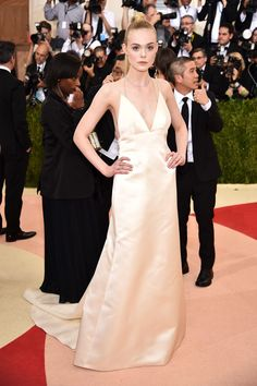The Fashion-Tech Looks From The 2016 Met Gala  #refinery29  http://www.refinery29.uk/2016/05/109813/best-dressed-met-gala-2016#slide-20  Elle FanningDidn't think the whole bedroom-dressing trend could make it to the Met Gala red carpet? Allow Elle Fanning to show you how it's done in what looks like a formal, structured take on a satin nightgown, designed by Thakoon. Minimal jewelry was the name of tonight's game for many of the celebs, as you can see with Fanning's fine lariat of…