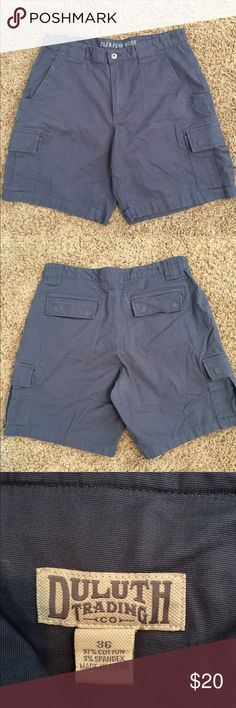 """Duluth Trading Co Mens Flex Fire Hose Shorts Sz 36 Duluth Trading Co men's flex fire hose shorts  Color gray/dark bluish gray Size 36 Measurements Laying flat waist measures 17.5"""" (total 35"""") unstretched Front rise 12"""" Inseam 9""""  Pre-owned with no holes, stains or tears Shorts Cargo"""