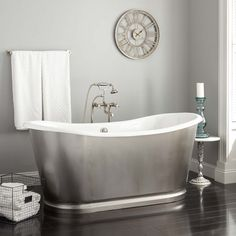 Whether in use or not, the distinctive Dorset Cast Iron Bateau Tub makes an impression. Surrounded by a contrasting stainless steel skirt, this tub has a classic bateau shape that brings an intriguing look to a bathroom suite. Steel Tub, Copper Tub, Free Standing Tub, Copper Soaking Tub, Signature Hardware, Bathroom Design, Slipper Tubs, Tub, Pedestal Tub