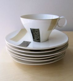Block graphic asian modern cups and plates, black and tan porcelain. $38.00, via Etsy.