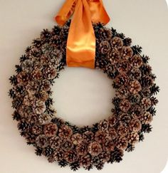 free pinecone wreath, crafts, seasonal holiday decor, wreaths, Adding a large satin ribbon seems to pull everything together Thanksgiving Wreaths, Fall Wreaths, Christmas Wreaths, Christmas Crafts, Door Wreaths, Pine Cone Crafts, Wreath Crafts, Diy Wreath, Wreath Ideas