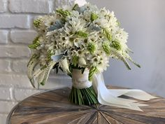 Gorgeous Bridal bouquet created with Star of Bethlehem, dusty miller, and sweet veronica. Just another day in paradise!