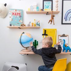 """: Busy busy : My three year old is loving his new desk. He had to finish his 'work' before I could tuck him in tonight! He loves exploring the globe and…"""