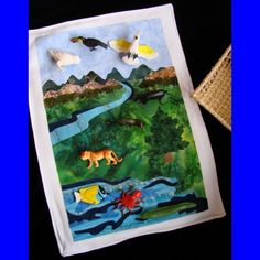 Air, Land and Water quilted mat