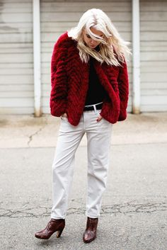 Always Judging wearing a rockstar-worthy red fur jacket + white boyfriend jeans