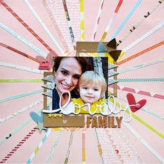 Lovely Family scrapbook layout by Paige Evans. Very pretty and love the beams coming out of the photo