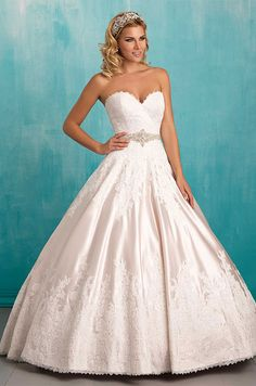 Lush satin composes the full skirt of this strapless ballgown, edged in lace and finished with a sweetheart neckline. Photos of Allure Bridal's Spring 2016 wedding dress collection.
