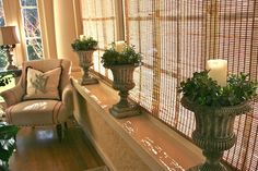 love the look of urns at the windows....change out seasonally....love this!