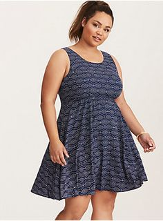 """You know the saying: when the temperatures rise, cut out the back of your sundress. Isn't that how it goes? The navy border print challis on this tank style is a lightweight must-have for any sweaty, sticky outing. The cutout back gets a little country-fied with a tie.<div><br></div><div><b>Model is 5'9"""", size 1<br></b><div><ul><li style=""""list-style-position: inside !important; list-style-type: disc !important"""">Size 1 measures 41"""" from shoulder</li><li style=""""list-style-position:..."""