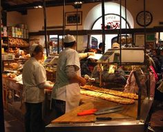 Forno Roscioli Pietro: Pizza counter at Roscioli | Antico Forno Roscioli – At this historic bakery, you'll find metre-long Roman pizza sold by the slice. Be sure to tell the person behind the counter just how much you'd like. Keep an eye out for pizza bianca, flatbread brushed with olive oil, and pizza rossa, crispy flatbread lightly topped with tomato sauce.