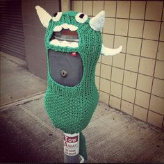 Meter Monster: yarn bomb (randomly covering public items and places with your knitted or crocheted skills.Meter Monster: yarn bomb (randomly covering public items and places with your knitted or crocheted skills. Yarn Bombing, Guerilla Knitting, Urbane Kunst, Textiles, Crochet Yarn, Freeform Crochet, Crochet Crafts, Yarn Crafts, Crochet Ideas
