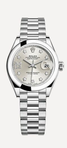 The Lady-Datejust 28 in platinum with a domed bezel and a silver dial with star-shaped, diamond-set hour markers.