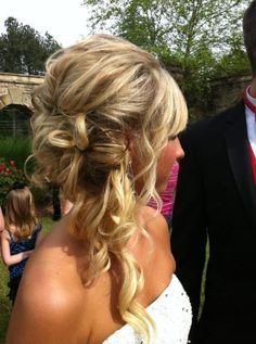 Long messy hair pinned up to the side for a cute prom look