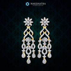 The artistic swirls in these Nakshatra diamond earrings cascade to gentle drops, radiating divine bliss for wedding ceremonies.