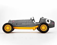 This listing is for one print of a toy Racecar This is part of the vintage models of yesteryear matchbox car set. Perfect for your boys room or nursery. Please select either photo or canvas as well as the size youd like where it says select diameter from the drop down as you place it in your cart.