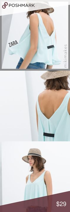 """ZARA • ice blue trapeze crop tank black ribbon • look cool in this ice blue trapeze crop tank from Zara TRF collection • double layered • deep v-neck and back • black grosgrain ribbon at the back • ribbon is a little loos at the back, needs a few stitches  100% polyester  ✂️  Bust = 42"""" ✂️  Length = 20""""  • sorry no trades • please feel free to ask any questions  ❤️,  @mikimakes  071417.bin3.29 Zara Tops Crop Tops"""