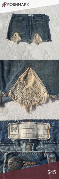 """Free People - Mini Jean Skirt Distressed and ragged bottom edge, doily like triangular cutouts on the front, three front pockets and two in the back, 15"""" waistband, 10 1/2 inch length. Free People Skirts Mini"""