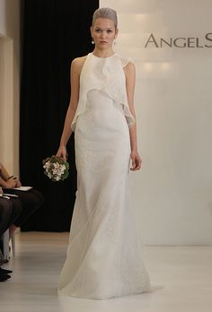 Brides.com: . Sleeveless chiffon sheath wedding dress with a ruffled layered bodice and beaded details, Angel Sanchez