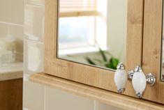 Decorative handles on a wooden bathroom storage cupboard from Utopia Bathrooms.
