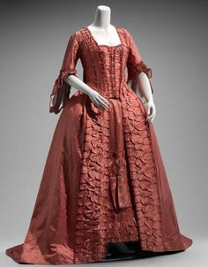 """This rich persimmon robe a la française is made with a """"compere"""" or """"false waistcoat"""" front instead of a stomacher. On the whole, Mrs Daffodil prefers the smoother lines of a stomacher. French, c. 1760s http://www.mfa.org/collections/object/womans-dress-in-two-parts-robe-petticoat-556860"""