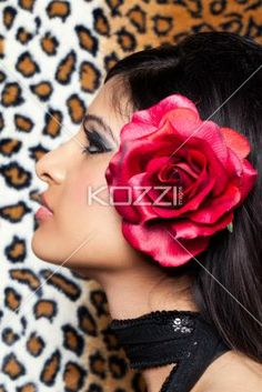 profile view of a woman posing with a rose in her hair. - Profile view close-up of a woman posing with a rose in her hair, Model: Stephanie Reddy