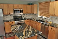 This Supreme Fantasy Granite kitchen is a good example of the everyday quality of work the company performs. Producing an average of 30 kitc...