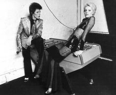 David Bowie and his ex-wife Angie 70s. he's wearing 70's clothes she's wearing 80's clothes before the 80's
