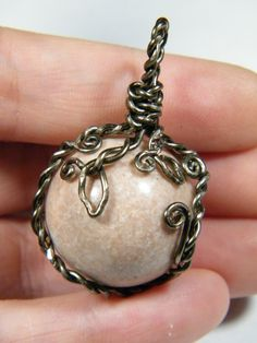 Wire wrapped natural Pink Marble sphere by NoStoneLeftUnturned