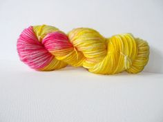 I love wool, textiles and colour. And so decided to start making my own Hand Dyed Wool and Yarns.  The base for this Yarn is 100% Wool in Superwash DK weight. It has been hand dyed by myself with professional Acid Dyes. This skein has been dyed so that it has a variegated look, it was inspired by one of my favourite puddings, Rhubarb and Custard. There are lovely shades and tones of yellow running through out the skein, i have added a splash of Pink to the skein to represent the Rhubarb…