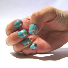 monday manicure: tiffany inspired  opi funny bunny as the base white color  opi happy anniversary!  china glaze for audrey