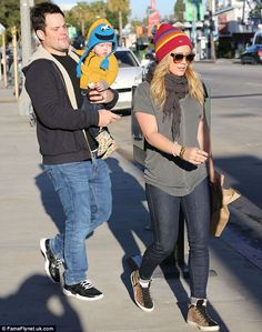 Just like mummy! Hilary Duff and her adorable baby son Luca wrapped up in fun knitted beanie hats as they enjoyed a day of family fun with Mike Comrie on Sunday